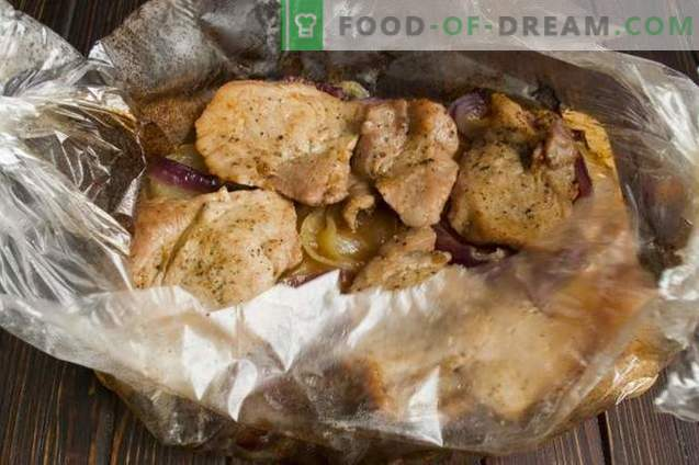 Delizioso maiale con ceci e cipolle nel forno
