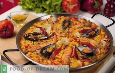 Paella con frutti di mare - plov in stile spagnolo. Cucinare paella con frutti di mare e fagioli, mais, piselli, pesce