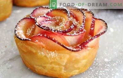 Rose sfoglia con mele - decorazione della tavola vacanza. Gli ospiti a sorpresa sbuffano le rose con le mele